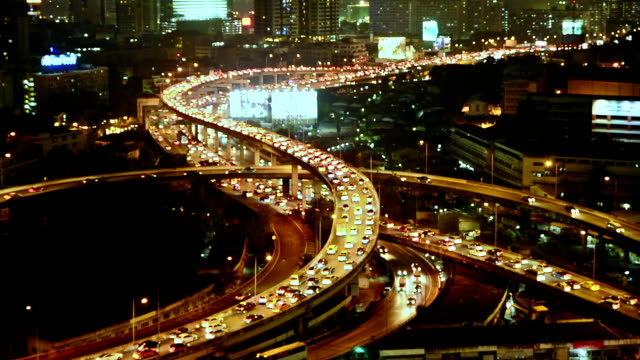 Bangkok City Traffic at night or Twilight, Aerial view of Expressway or Autobahn in Thailand.