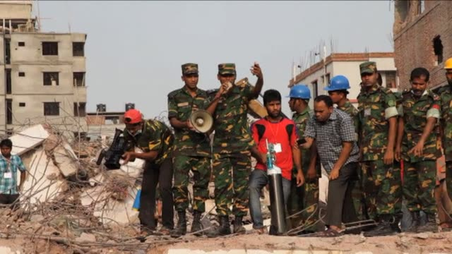 Bangladeshi rescuers pulled a woman alive from the ruins of a collapsed garment factory complex on Friday after she spent 17 days trapped in a...