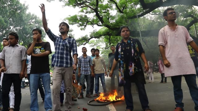 Bangladeshis shout slogans during a protest against the removal of a Lady Justice statue in Dhaka Bangladesh Friday May 26 2017 A Lady Justice statue...