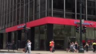 Bank of America locations in downtown Chicago IL on July 9th 2017 Shots wide shot from across the street of a Bank of America location with traffic...