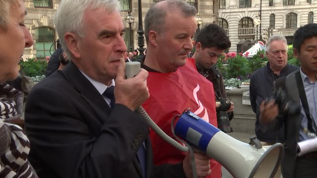 McDonnell supports striking workers England London City of London EXT John McDonnell MP addressing striking Bank of England workers using loudhailer...