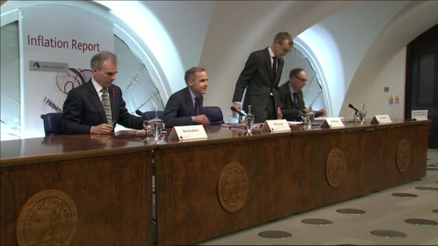 Bank of England raises interest rates for first time in a decade INT Mark Carney and others into room and taking seats Mark Carney press conference...