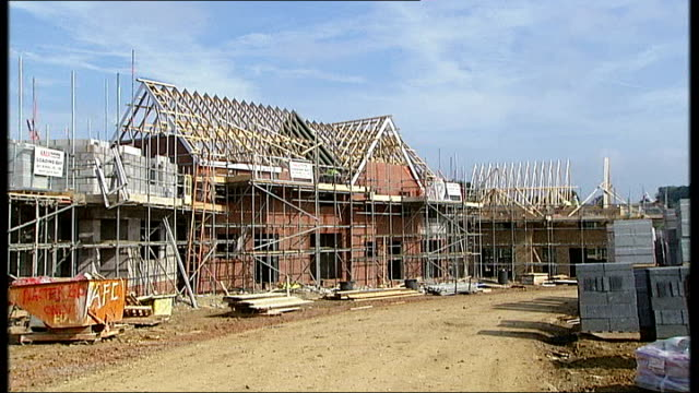 Bank of England warn house market boom is 'biggest risk' to economic recovery T24091316 / Stevenage Houses under construction covered with scaffolding