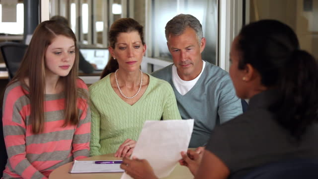 MS Banker Discussing College Loans with Teenager and Concerned Parents / Richmond, Virginia, USA