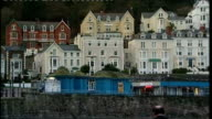 Banking Commission says banks need 'electrified' ringfence WALES Conwy EXT Back view Jones along beach ZOOM IN 'The Elm Tree' hotel in background...