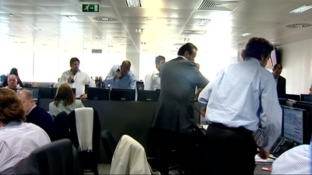 Lloyds TSB HBOS possible merger BGC trading floor Traders at desks in dealing room / traders shouting across room as standing at desks and speaking...