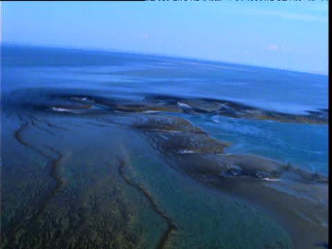 Banking track over rushing tidal water through gaps in Buccaneer Archipelago, Western Australia