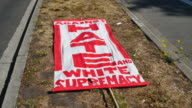 Banners against hate are placed during the Bay Area Against Hate rally near the Crescent at UC Berkeley in Berkeley California Several thousand...
