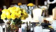 Banquet hall, restaurant. Waiter serving table prior ceremony, event.