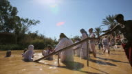 Baptismal ceremony at Qasr el Yahud baptism site in the Jordan River Valley, Israel