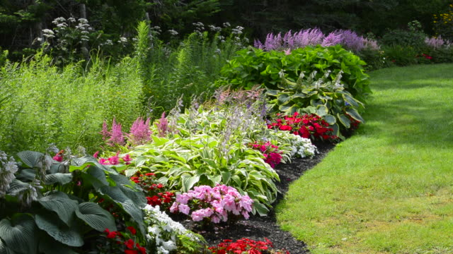 Bar Harbor Maine colorful flower gardens and arch in yard of home in summer