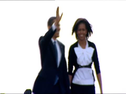 Barack Obama and Michelle Obama arriving on stage and waving to crowd / Prague Czech Republic