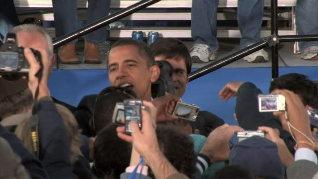 Barack Obama Democratic candidate for US President shaking hands in crowd during rally in Ida Lee Park on October 22 2008 / Leesburg Virginia USA