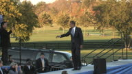 Barack Obama Democratic candidate for US President walking onstage and raising hands with Senatorelect Mark Warner and Governor Tim Kaine during...