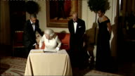 Day 2 Queen Elizabeth departs Winfield House ENGLAND London Winfield House INT Queen Elizabeth dress into hallway with Prince Philip Duke of...