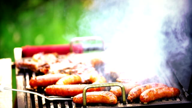 Barbecue meat sizzling.