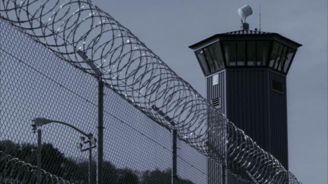 LA MS Barbed wire fence outside guard tower at Sacramento State Prison / Folsom, California, USA