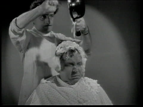 1947 MONTAGE Barber giving customer odd shampoos dumping food on man's head / United States