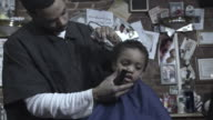 MS ZI CU FROZEN, Barber trimming boy's (2-3) hair, Brooklyn, New York, USA