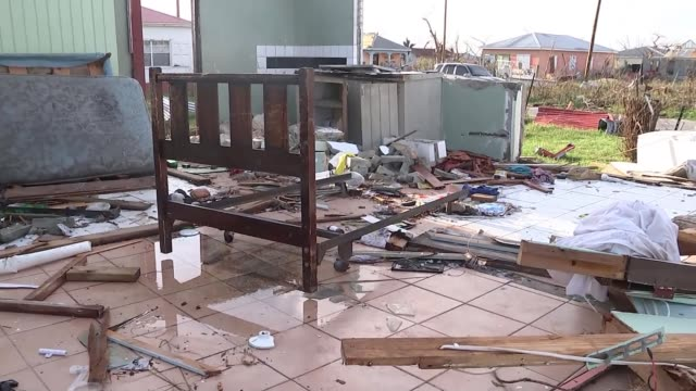 Barbuda residents accuse government of land grab following Hurricane Irma T08111734 8112017 Houses damaged by Hurricane Irma Electrical wires and...