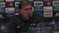 Barcelona coach Gerardo Martino responds to criticism of his side's style of play by joking they are in crisis ahead of their Champions League clash...