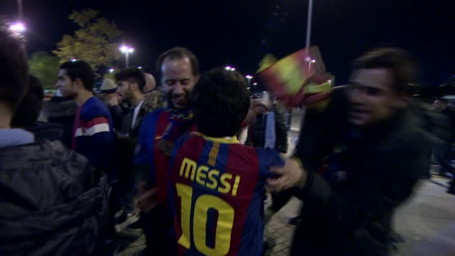 Barcelona fans wearing the shirts of Lionel Messi Luis Suarez and Neymar before their sides match against Manchester City at the Etihad Stadium
