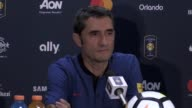 Barcelona manager Ernesto Valverde looks back to his side's 10 victory in their International Champions Cup friendly match against Manchester United...