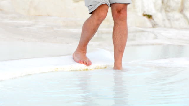 Bare feet in thermal water