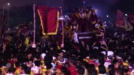 Barefoot men and women in search of miracles hurl themselves above huge crowds in the Philippines to touch a centuriesold icon of Jesus Christ as one...