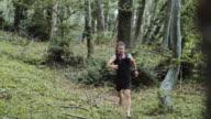 Barefoot runner running in the forest