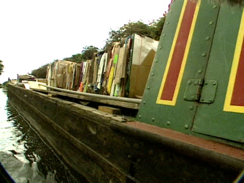 A barge carrying waste cardboard for recycling travels along a canal to Birmingham 2000