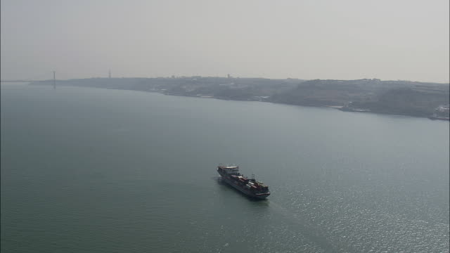 AERIAL WS Barge on Tagus River / Lisbon, Portugal