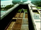 1969 MONTAGE Barge transporting freight rises in a lock gradually filling up with water/ USA/ AUDIO