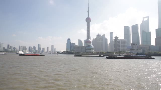 Barges travel down the Huangpu River in Shanghai China on Saturday Sept 26 Barges sail past the Oriental Pearl Radio TV Tower left and other...