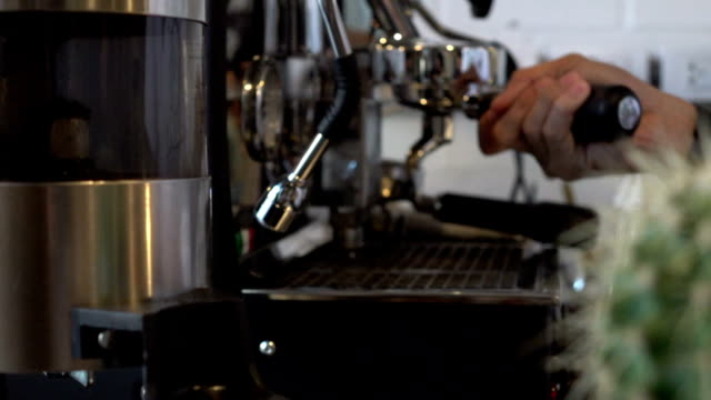 Barista making a cup of coffee