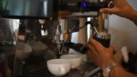 Barista making two of coffee latte in coffee bar