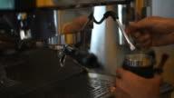 Barista making two of coffee latte the coffee bar.
