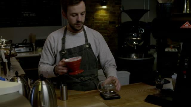 Barista preparing drip brew coffee