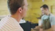 Barista Talks With Customer