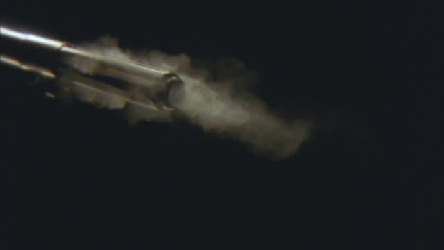 SLO MO, CU, Barrel of rifle firing bullet