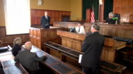 Barrister questioning Witness in court (USA flag)
