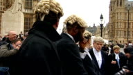 Barristers and lawyers protest against legal aid cuts ENGLAND London Westminster EXT Various of lawyer and barristers gathered on College Green with...