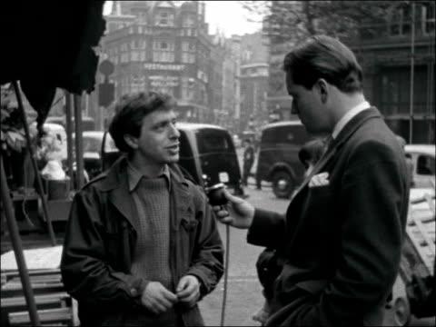 London EXT Bernard Kops arranging books on bookstall / Bernard Kops interview SOT Found it very difficult earning a living being a writer / I...