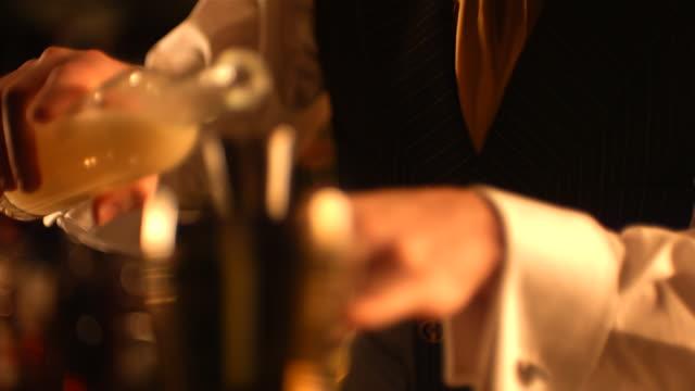 MS SLO MO R/F Bartender adding shot of to his mixer / United Kingdom