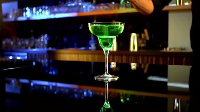 HD DOLLY: Bartender Garnishing A Cocktail