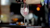 Bartender making red cocktail