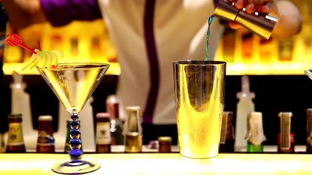 HD: Bartender mixing beverage for drink