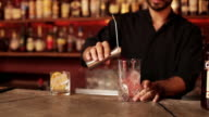 Bartender mixing cocktail
