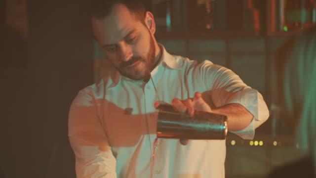 Bartender pouring drink 4K