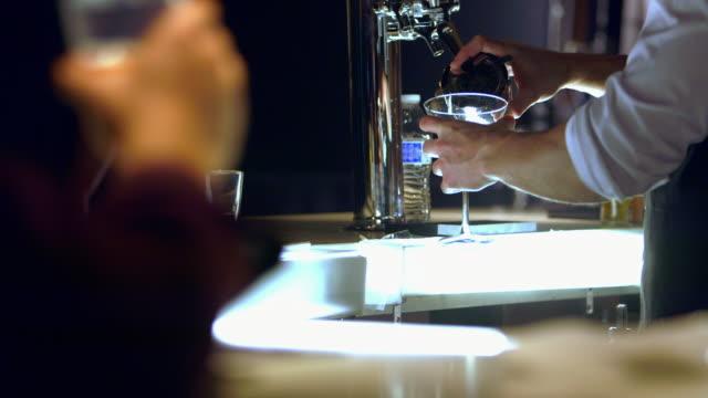 MS bartender preparing and serving martini
